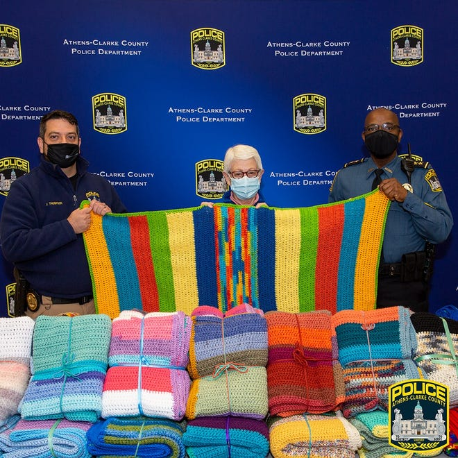 Jolene O'Brien, center, donated dozens of handmade crocheted blankets to the Athens-Clarke Police Department, which in turn gave them to Athens-Clarke County Family Protection Center.