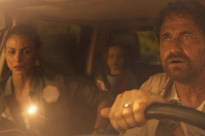 (L-R) Morena Baccarin, Roger Dale Floyd and Gerard Butler star in GREENLAND.