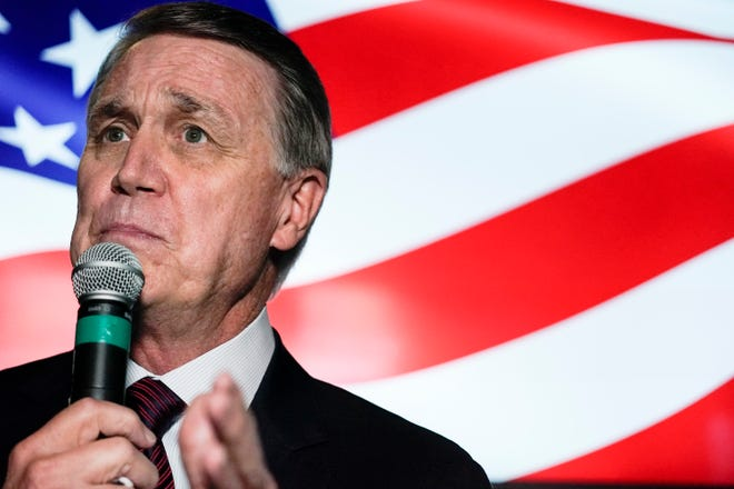 In this Friday, Nov. 13, 2020, file photo, U.S. Senate candidate Sen. David Perdue speaks during a campaign rally in Cumming, Ga.  (AP Photo/Brynn Anderson, File)