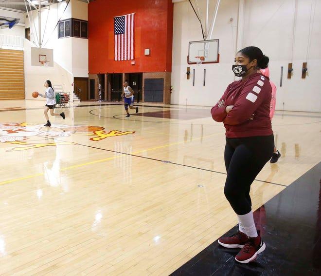 Paris Caldwell, the basketball coach for the Kenmore-Garfield girls basketball team keeps a careful eye on a recent practice at the school. [Karen Schiely/Beacon Journal]