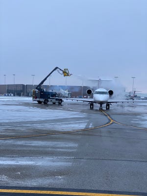 The first outbound flight on the new Washington-Dulles International Airport route readies for take off Friday at Akron-Canton Airport in Green.