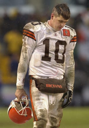 Former Browns quarterback Kelly Holcomb walks the sidelines as the Pittsburgh Steelers complete a 36-33 comeback win in the fourth quarter of an AFC wild-card playoff game in Pittsburgh after 2002 season. [Chris Gardner/Associated Press file]