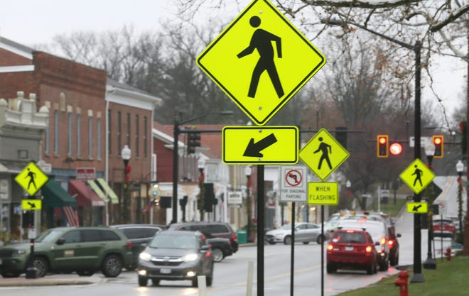 Crosswalk signs line Main Street throughout downtown Hudson. City Council is examining pedestrian safety at intersections throughout the city.
