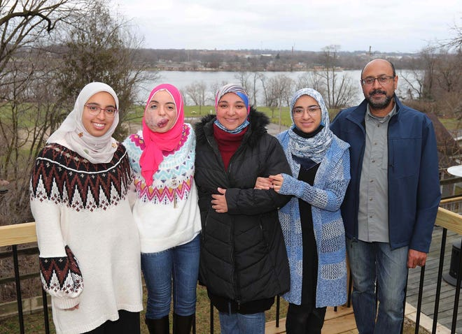 Lamise ElBetar, second from left,  stands with Toqa Hassan, Ghada Awad, Eman Hassan and Nasser Razek at the Akron home of Awad and Razek. The family has become like her second family while she has been living in Akron.