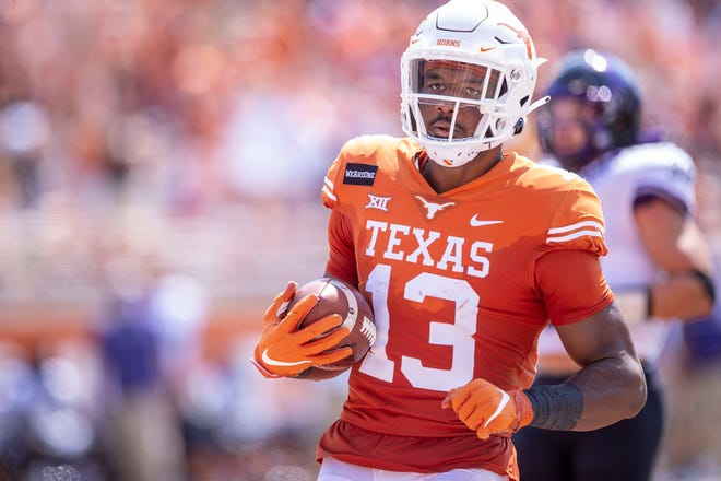 Texas Longhorns wide receiver Brennan Eagles runs into the end zone against the TCU Horned Frogs during their game in October at Royal-Memorial Stadium. Eagles announced Tuesday that he'll skip the upcoming bowl game and enter the NFL draft.