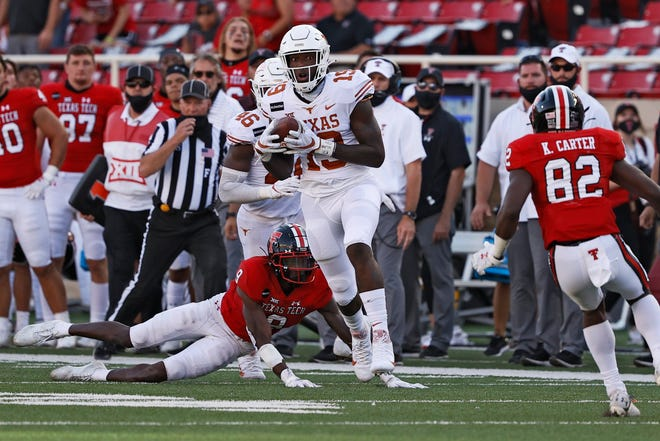 Texas' Malcolm Epps (19) recovers an onside kick during the second half an NCAA college football game against Texas Tech, Saturday, Sept. 26, 2020, at Jones AT&T Stadium in Lubbock, Texas.