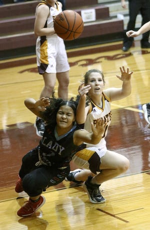 Alliance's Mianna Ford, left, and Southeast's Olivia Neer go for a loose ball during action at Southeast High School Monday, December 21, 2020.