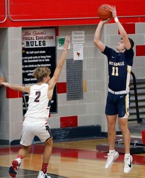 Hillsdale's Caden Mutchler shoots over Loudonville's Kyle Maltarich (2) during high school boys basketball action Monday at Loudonville High School.  Mutchler and the Falcons defeated Loudonville, 61-55.