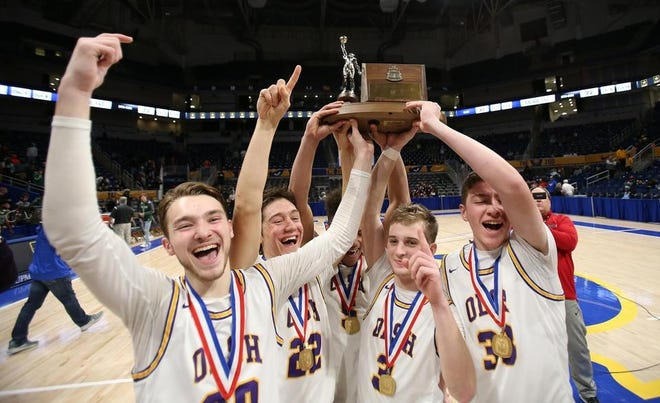 The OLSH boys basketball team celebrates its WPIAL Class 2A championship last season. The WPIAL adopted an open tournament format for this year's playoffs as a result of unbalanced scheduling due to the COVID-19 pandemic.
