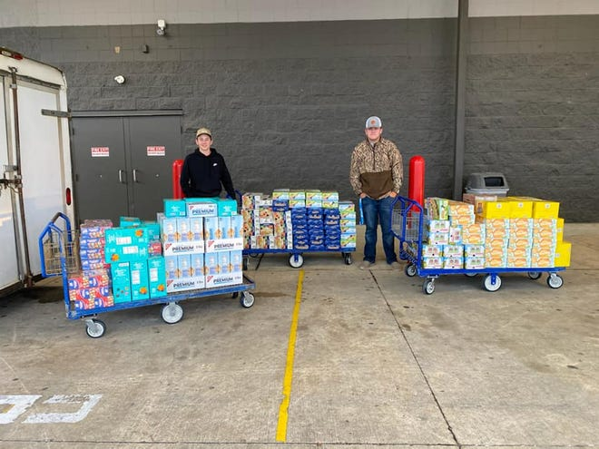 Vernon Parish 4-H'ers stand with food items they collected to be delivered to local students in need ahead of the Christmas break.