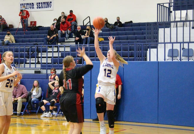 Bluestem's Kristyn Cooper goes in for the runner against county rival Flinthills on Monday, Dec. 21 at Bluestem High School. Cooper scored 21 points in the 67-36 win over the Mustangs.