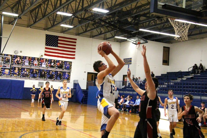 Bluestem's Cooper Larsen (12) goes up for a layup on a breakaway bucket in the second quarter on Monday, Dec. 21 at Bluestem High School. The senior finished with 10 points in the win over Flinthills.