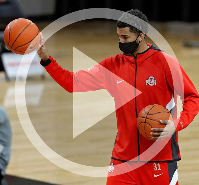Ohio State forward Seth Towns distributes basketballs during warmups before the Buckeyes' game on Nov. 29, 2020 against UMass-Lowell.
