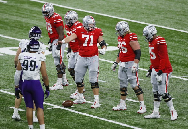 Center Josh Myers (71) returned to anchor the Ohio State offensive line in the Big Ten championship game against Northwestern.
