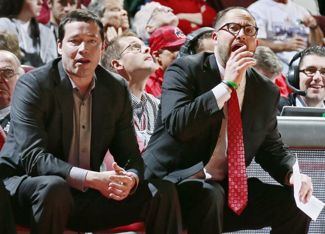 """Ohio State women's basketball head coach Kevin McGuff, left, and former assistant coach Patrick Klein watch a Buckeyes exhibition game in 2017. Klein, who resigned from the program in 2019, wrote in his resignation letter that he had """"not adhered strictly to NCAA rules."""""""