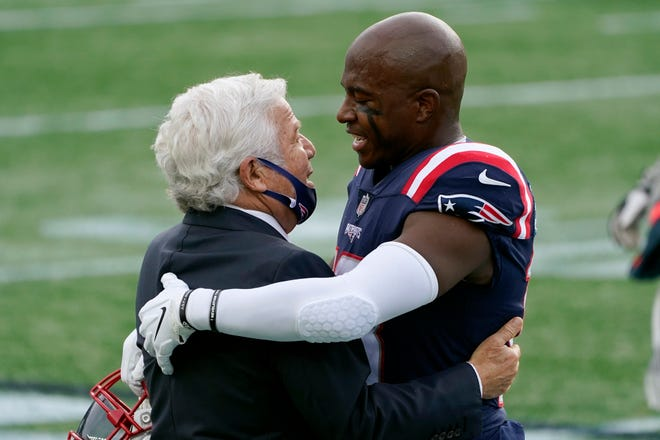 New England Patriots owner Robert Kraft, left, embraces special teams captain Matthew Slater before an Oct. 26 game against the San Francisco 49ers in Foxboro.