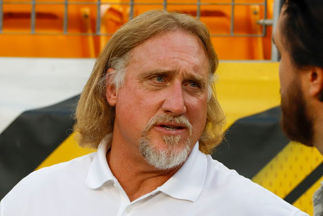 Pro Football Hall of Fame outside linebacker Kevin Greene stands on the sideline before a September 2019 game between the Pittsburgh Steelers and the Cincinnati Bengals in Pittsburgh. Greene, considered one of the fiercest pass rushers in NFL history, died Monday at 58.