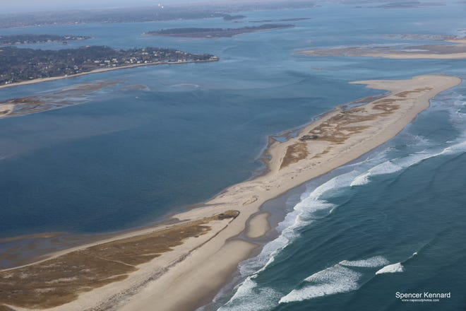 Storm -churned seas washed over North Beach in Chatham after a Dec. 17 nor'easter. The thinning of the barrier beach poses an erosion threat to the town lining the harbor.