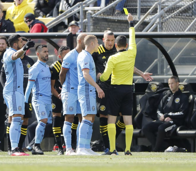 Crew defender Vito Wormgoor draws a yellow card during the first half of the 2020 season opener against New York City on March 1 at Mapfre Stadium.