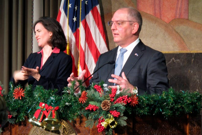Louisiana Gov. John Bel Edwards, with a sign language interpreter to his left, speaks at his latest briefing on COVID-19 on Dec. 2 in Baton Rouge.