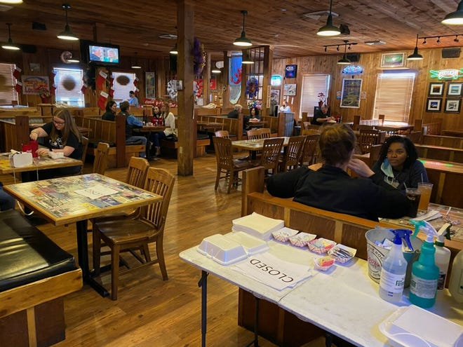 "Big Al's Seafood Restaurant in Houma, with tables marked ""Closed"" to help with social distancing and capacity restrictions."