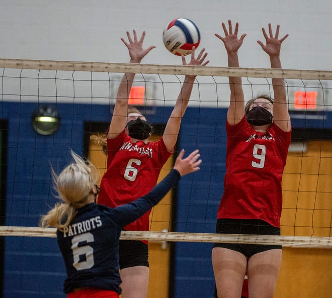Wheatmore's Kara Moore and Emma Atwell go up for the block against Providence Grove's Jill Stern as the two teams battle it out in the PAC-7 on Monday. (PJ WARD-BROWN/THE COURIER-TRIBUNE)