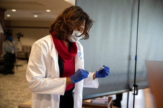 A healh care worker prepares COVID-19 vaccines at the UF Villages Hospital. [Cindy Peterson/Correspondent]