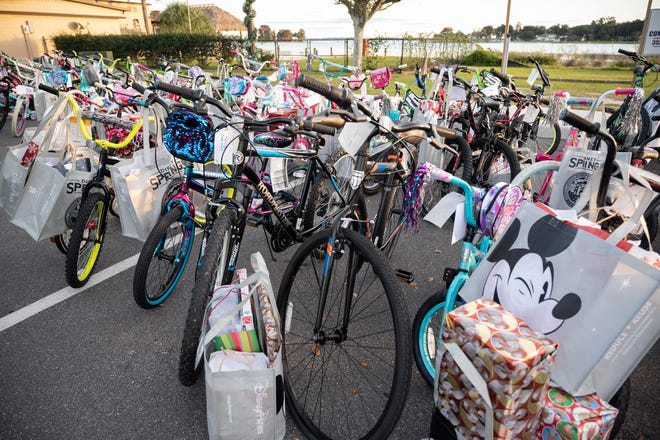The Leesburg Police Department gave away around 75 bicycles to local kids at their annual bike give-a-way on Monday. [Cindy Peterson/Correspondent]