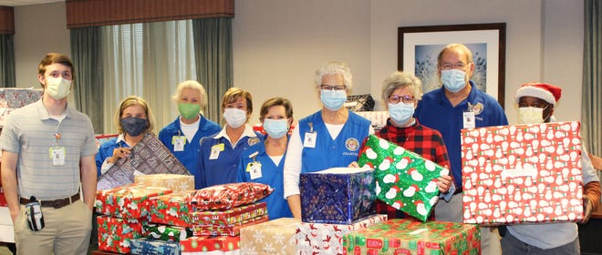 Maury Regional Medical Center staff prepare gifts for distribution to local students as part of its Holiday Hugs program. Pictured, from left to right,  are Brandon Ginsberg, supply chain specialist; volunteers Pam Langford, Suzanne Parks, Cindy Johnson, Alice Williams, Debbie Massey; Cindy Short, director of volunteer services; volunteer John Massey; and groundskeeper James Caruthers during the sorting and distribution of gifts for Holiday Hugs.