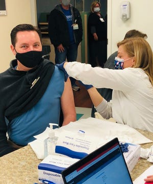 Dr. Michael Kidder, a pediatrician with Wake Forest Baptist - Lexington Pediatrics, was the first doctor to receive the Moderna COVID-19 Vaccine Tuesday morning.