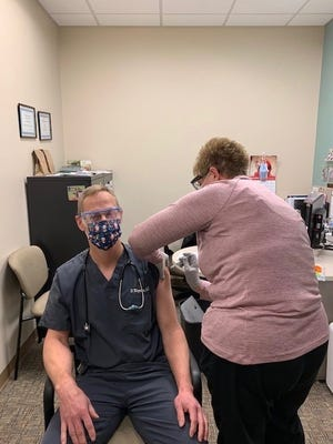Altru Devils Lake Clinic Dr. Derek Wayman receives the Pfizer COVID-19 vaccine.