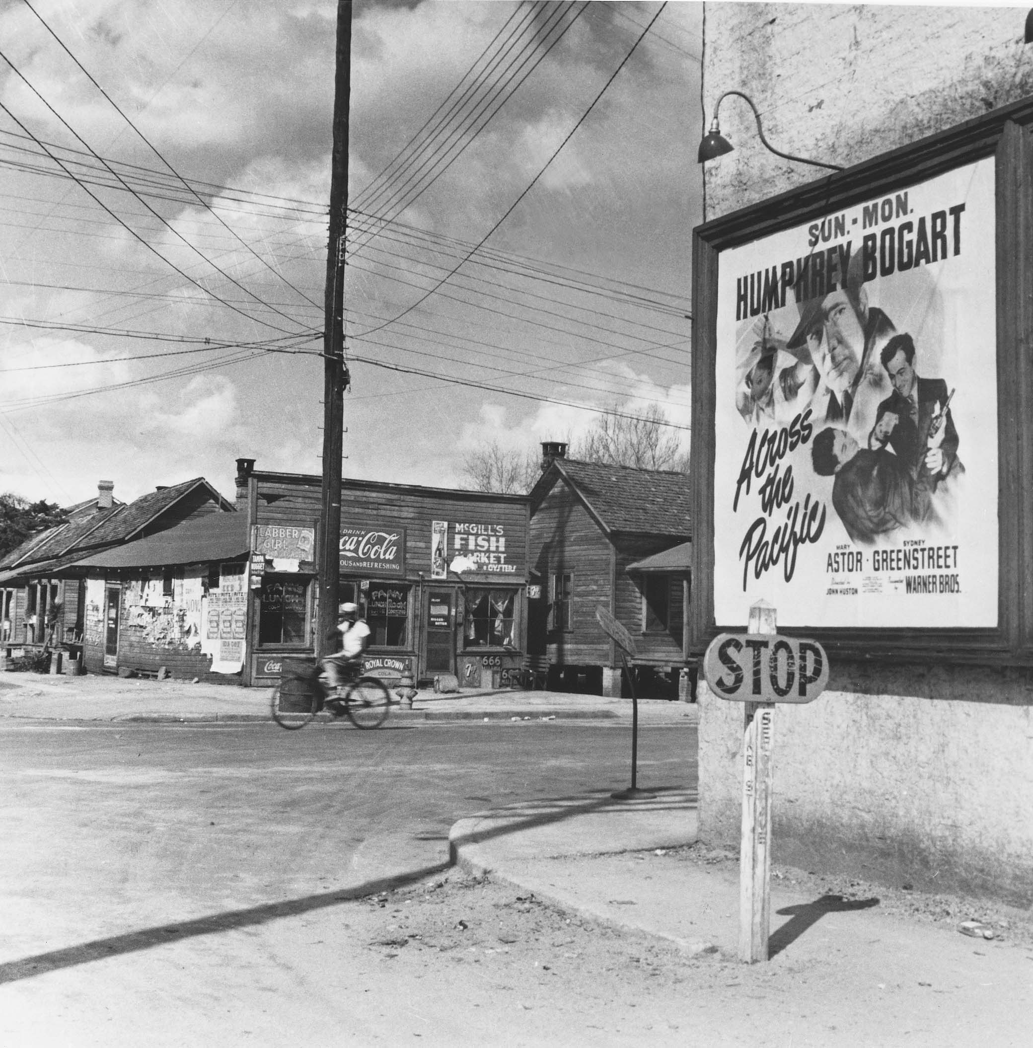 Midtown's Second Avenue was a very different place when this photo was taken in early 1943. Notice the wooden stop sign with the street name on the post.