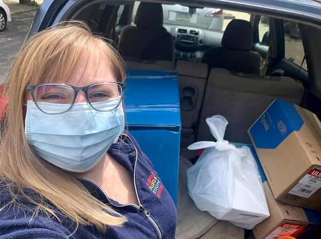 """Molly Martin Wright and her new husband, James """"Jimmy"""" Wright Jr., D.O., helped raise more than $70,000 to purchase desperately needed supplies and delivered them to area hospitals."""