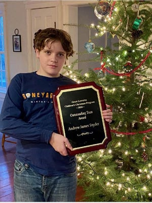 Andrew Snyder was presented with an Outstanding Teen Award plaque by the Gram Lorraine Christmas Program for his idea and donation to help struggling families.