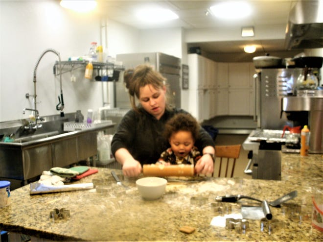 Allie and Nolan bake cookies at Lydia's House of Hope in Somersworth.