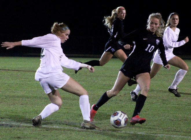 Fleming Island midfielder Madison Male (12) and Bartram Trail defender Emily Toenjes (10) challenge for possession during a December game.
