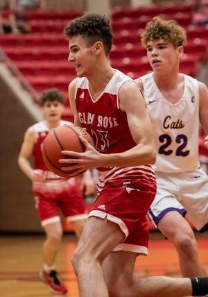 Glen Rose's Caden Schinagel drives to the basket against Godley on Friday night.