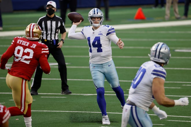 San Francisco 49ers defensive end Kerry Hyder Jr. (92) rushes as Dallas Cowboys quarterback Andy Dalton (14) throws a pass in the first half in Arlington on Sunday. (AP Photo/Ron Jenkins)