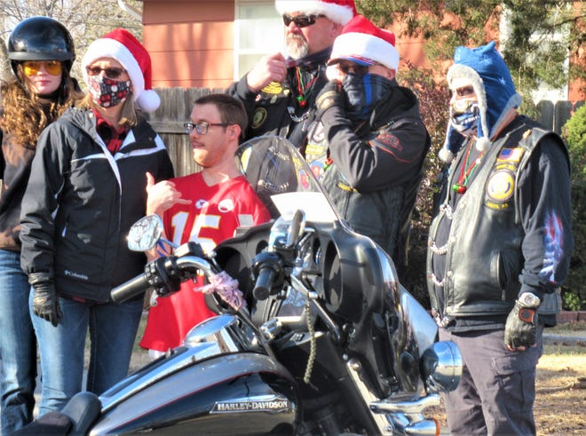 Jacob Houghton, DSNWK resident in red shirt, greeted the American Legion Riders who delivered his gift bag. Left to right, Caitlin Farrell, Claudine Richmeier, Ray Palmer, Mark Richmeir and Vince Griego.