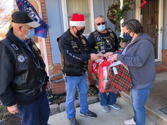 Angie Rupp gets help for delivering gift bags from American Legion Riders Gary Dutcher, Charles Timmons and Brian Roe.