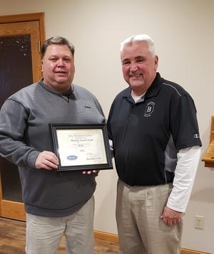 Kyle Beckwith a member of the Kansas Funeral Directors Association Board of Directors presented Ron Keithley with an award to honor the years of service provided by Keithley Funeral Chapel in Ellis.