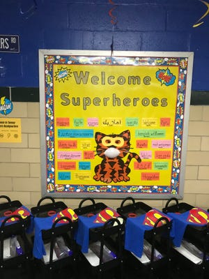 """A sign at James Tansey Elementary School welcomes back its """"superhero"""" students."""