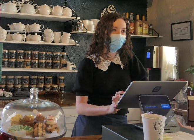 Emily Hall takes an order at The Teahouse at Clifton Square in Wichita.