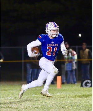 Canton-Galva's Tyson Struber returns a kick during a playoff game against Madison. Struber committed to Kansas State on Saturday.