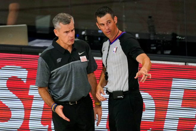 FILE - In this Monday, Aug. 31, 2020, file photo, then-Oklahoma City Thunder head coach Billy Donovan, left, talks with an official during the second half of an NBA first-round playoff basketball game against the Houston Rockets, in Lake Buena Vista, Fla. The Chicago Bulls made sweeping changes to their front office for the 2020-21 season and snagged Donovan, one of the top coaches on the market, hoping an overhaul in leadership will carry them back to respectability.
