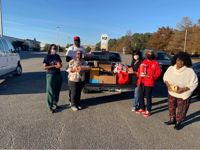 The Kinston Civitans recently provided items to go in the Blessing Box sponsored by Kinston Teens. Pictured, from left are Sharome Brown, Cheryl Clark, Rico Hargett, Marvette Spruill, Linda Smith, and Glinda Williams.[CONTRIBUTED PHOTO]