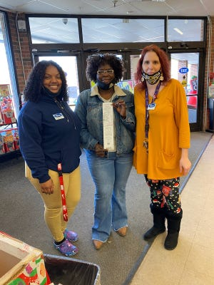 On Dec. 5, the Kinston Civitans played secret Santa and paid off a Christmas layaway at Roses in Kinston. Picture, Lucinda Pender, center, is pictured with Roses staff members. [CONTRIBUTED PHOTO]