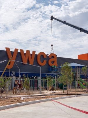 The sign going up on the YWCA Envision Center, which opened this year.