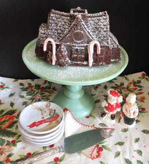 This gingerbread house is made in a Bundt pan. Add some powdered sugar and candy canes and you have the perfect holiday centerpiece.
