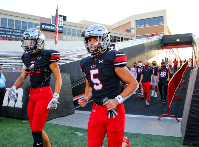 Jacob Politte runs out onto the field prior to an Oct. 9, 2020 neutral-site game against Frenship at Texas Tech's Jones AT&T Stadium. Politte, who earned a preferred walk-on spot as a deep snapper, participated in a signing ceremony Friday to play for Jackson State University.